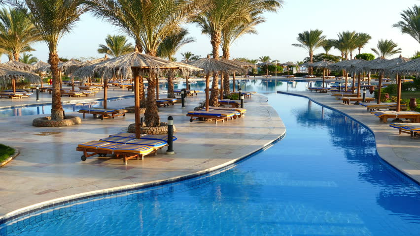 Hotel pool with people  EGYPT, SOUTH SINAI, SHARM EL-SHEIKH, SEPTEMBER 22, 2010: People In ...