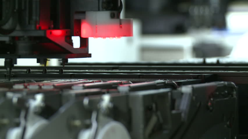 Close-up of automated electronics parts manufacturing line side view