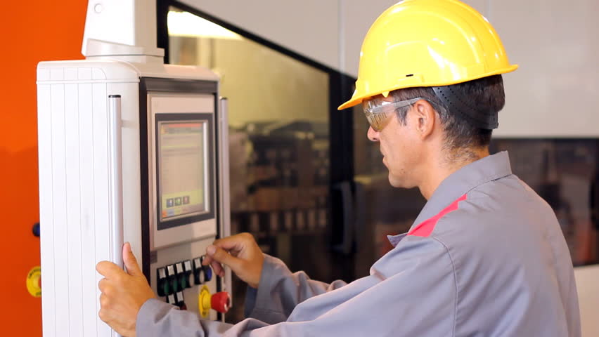 industrial worker cnc machining machine stock footage video (100cnc machining machine operator male worker using industrial control panel of the pet blow molding machine