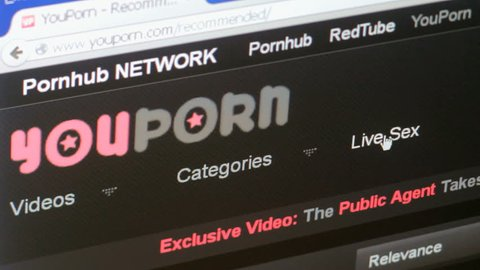 SAN FRANCISCO, CA - FEB 12: Surfing YouPorn adult pornography website on February 12, 2015. Forty-three percent of all internet users view online pornography.