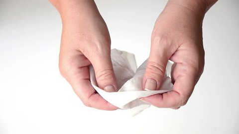 Wiping female hands by baby wipe.  Top view. Close up. Hands only. White background