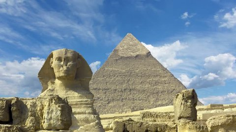 Clouds over great pyramid and sphinx at Giza Cairo in Egypt - timelapse 4k