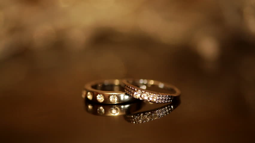 Wedding Rings On A Colorful Flashing Background Hd Stock Video Clip