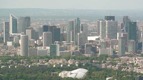 Aerial High-rise office buildings, La Defense corporate financial business district - Paris, France. La Defense is Europe's largest purpose-built business district with corporations headquartered