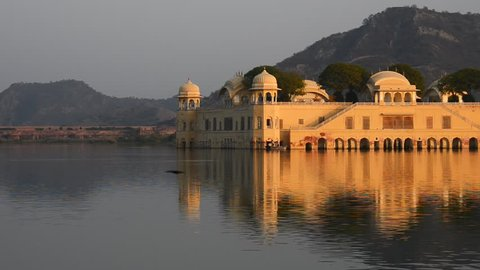 Water palace, Jal Mahal in Jaipur at sunset. Pan right.