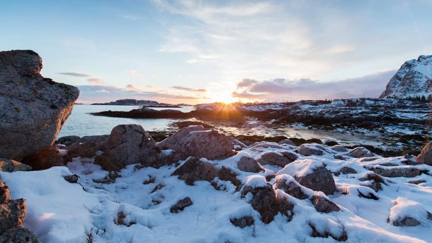 Snowy sunset in Norways coast of Lofoten Islands