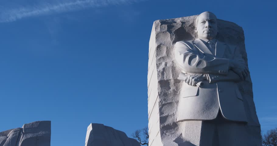 """MLK medium shot. The Martin Luther King, Jr. Memorial in Washington D.C. Winter. Blue sky. """"Out of the mountain of despair, a stone of hope."""" """"I Have A Dream"""""""