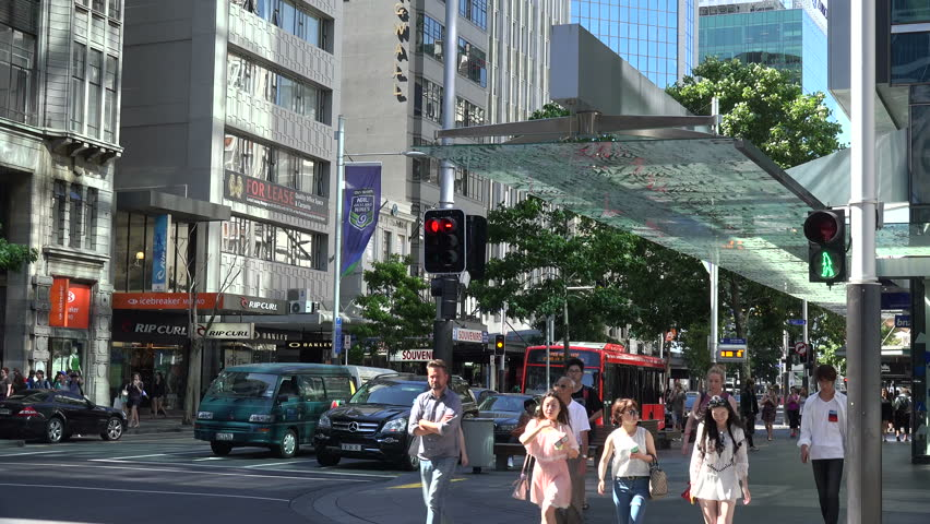 AUCKLAND, NORTH ISLAND/NEW ZEALAND - JANUARY 13, 2015: Unidentified  People walk along Queens Street in the city centre. Queen Street is the major commercial thoroughfare in the Auckland CBD. | Shutterstock HD Video #8951818