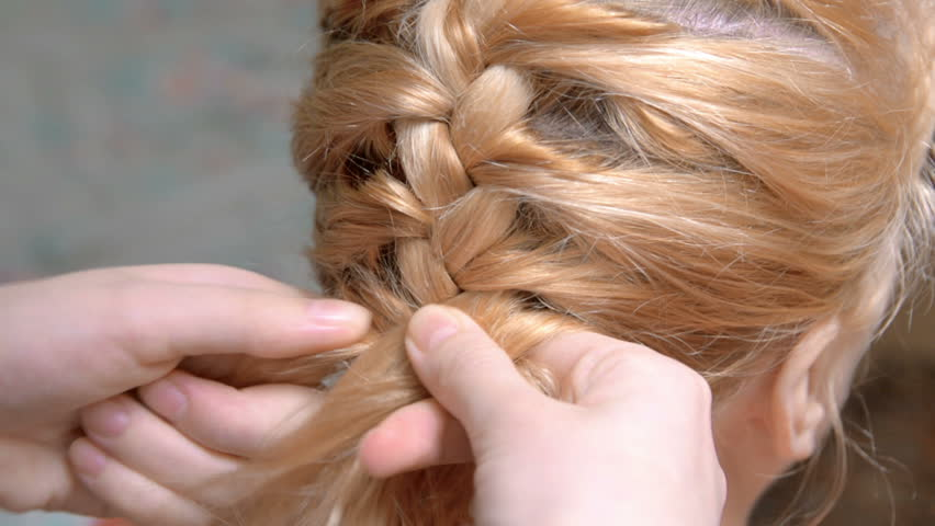 Weaving of hair on the head to the spit the French knot | Shutterstock HD Video #8953798