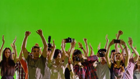 4K Crowd of fans and paparazzi on green screen . Dancing, photo shooting, Slow motion. Shot on RED EPIC Cinema Camera.