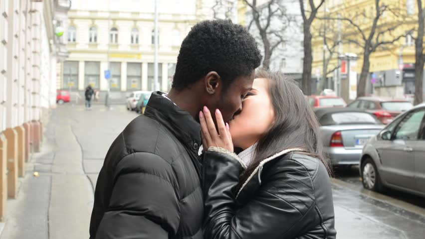man asian Black girl kissing