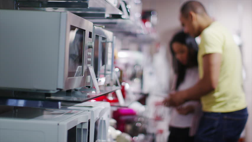 4k couple shopping in a store selling kitchen appliances, white