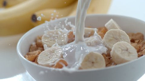 Milk pouring into bowl of cereal and bananas in slow motion; shot on Phantom Flex 4K at 1000 fps