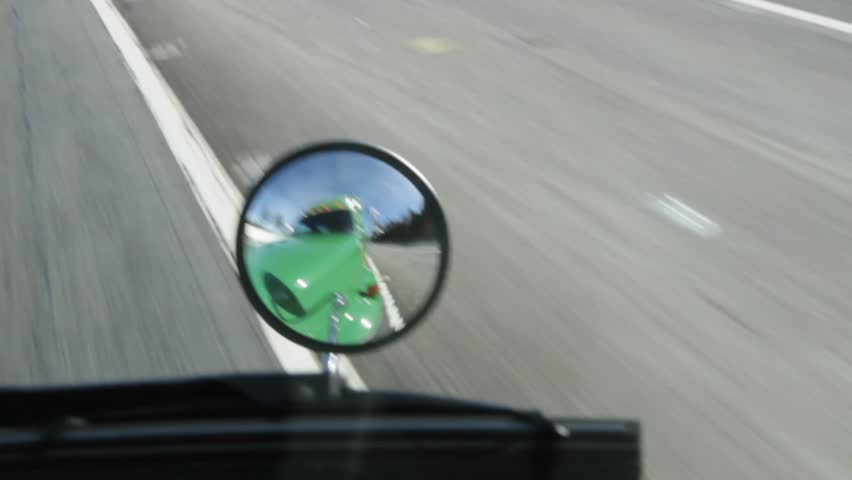 Pov of a truck on highway looking into mirror | Shutterstock HD Video #900634
