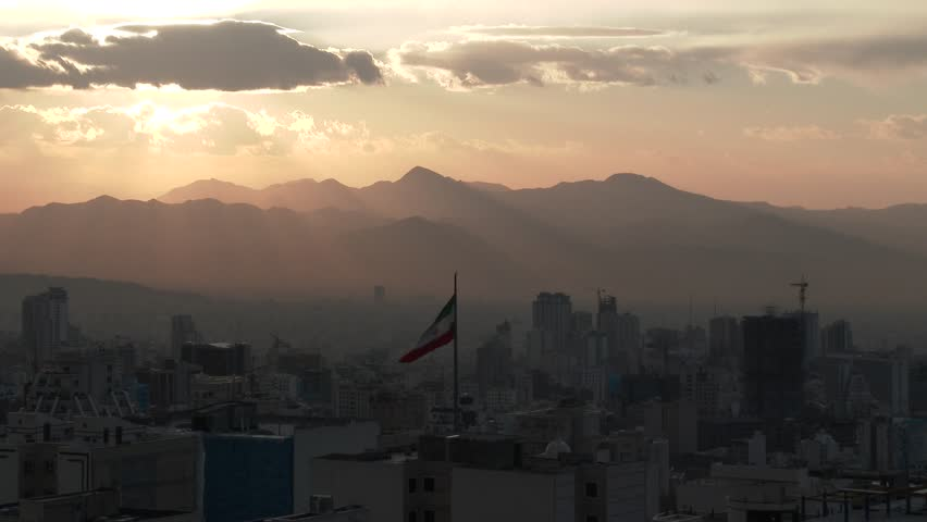TEHRAN, IRAN JANUARY 2015: Iranian flag in the middle of Tehran city. | Shutterstock HD Video #9009757