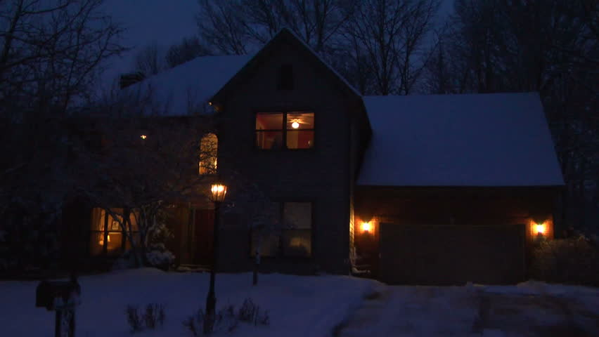 Front of a suburban home, taken in winter with the indoor lights on. Part of an establishing shot series.
