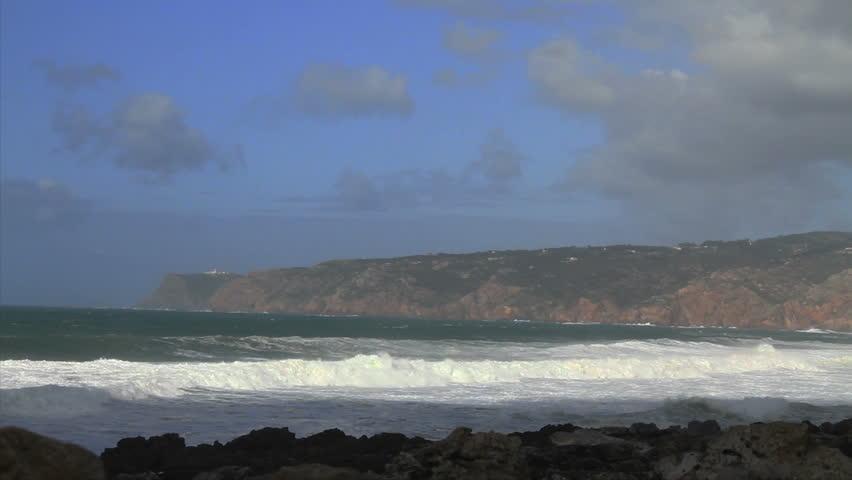 Atlantic coast Western Europe. Waves breaking. Breaking onto Rocks. Sky clouds | Shutterstock HD Video #9023638