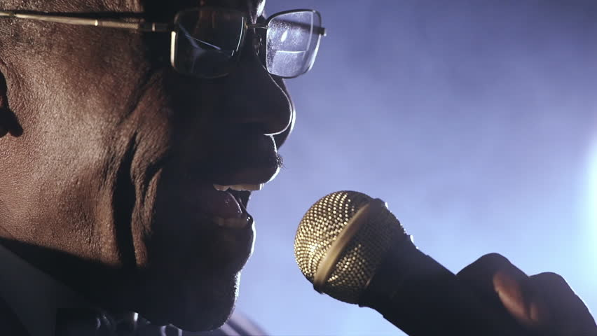 Old African black colored man singing microphone smoke | Shutterstock HD Video #9026398