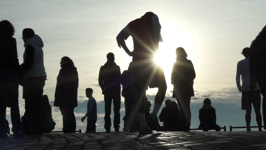 silhouettes walking people