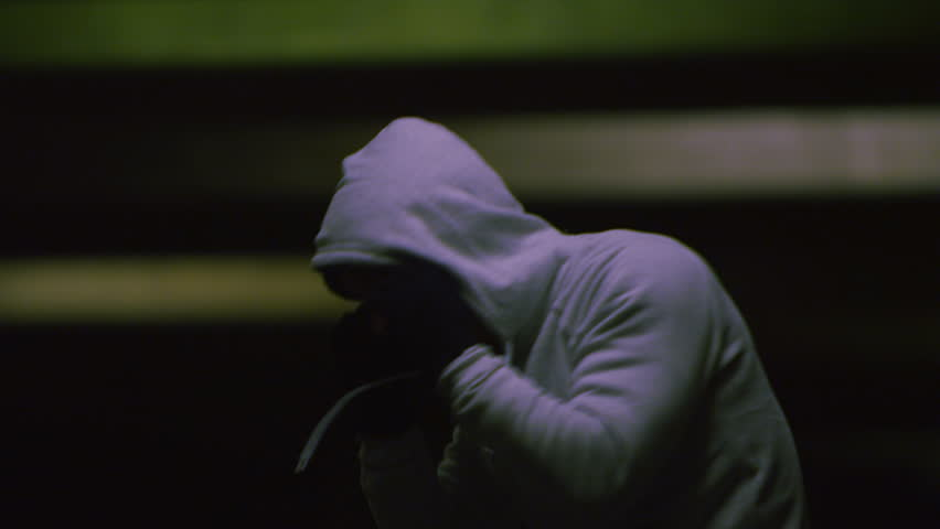 4K Hooded boxer training in low light at night in slow motion, shot on RED EPIC