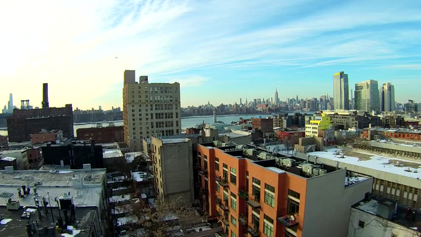 Williamsburg rooftop low aerials NYC skyline view. Winter aerials in Brooklyn, East River and Greenpoint New York.
