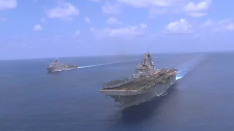 CIRCA 2010s - Good aerial over an aircraft carrier as sea with fleet.
