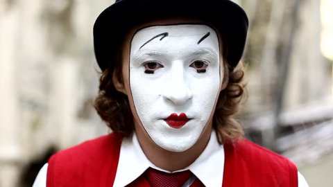 Mime on the street in Paris shows shows pantomime