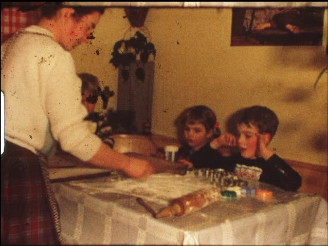 Children making Christmas cookies (vintage 8 mm amateur film)