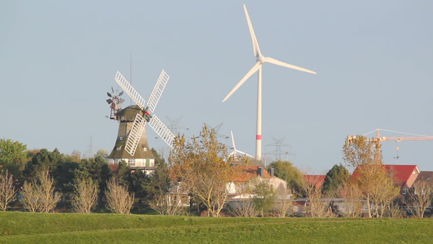 windmill and wind-turbines at carolinensiel, lower saxony, germany