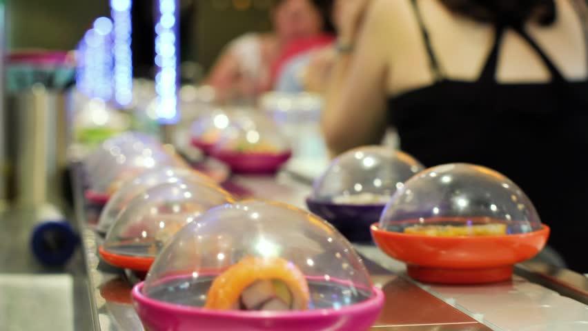 Sushi moving round a sushi bar