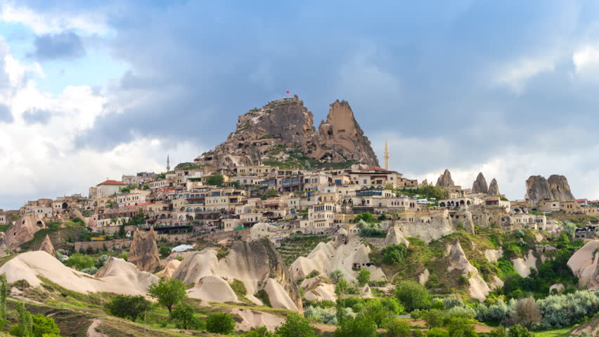 Amazing view of Turkish fortress Uchisar in the Cappadocia, Turkey. Zooming in timelapse video.