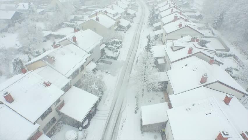 AERIAL: Blizzard in suburban town