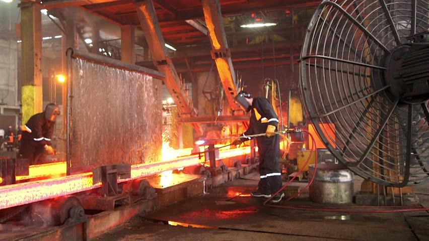 Steel making - male Workers cutting fiery steel blocks at the factory | Shutterstock HD Video #9218558