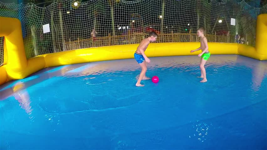 Twin Boys Playing With A Toy At A Swimming Pool Underwater View Stock Footage Video 2789032