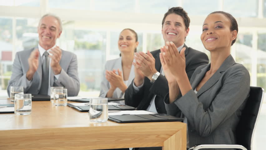 Business Team Smile and Applaud at a Meeting