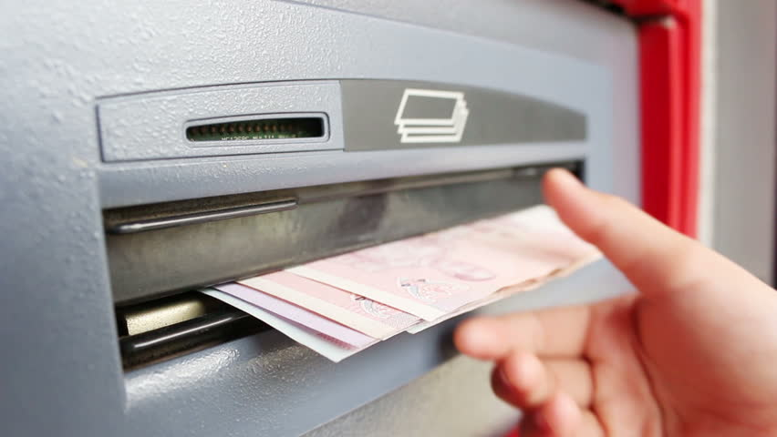 Woman withdraw cash from ATM