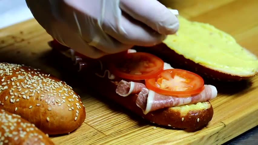 Sandwiches in the kitchen at the restaurant | Shutterstock HD Video #9318698