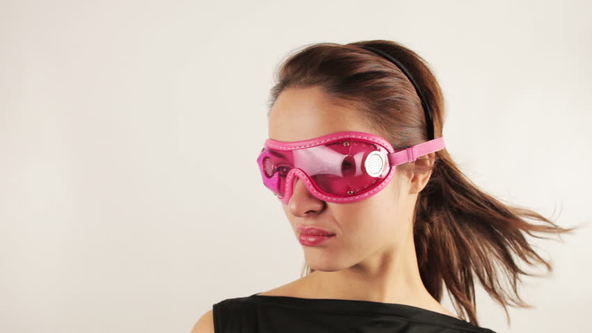 woman wearing cool goggles looking around and posing #934498