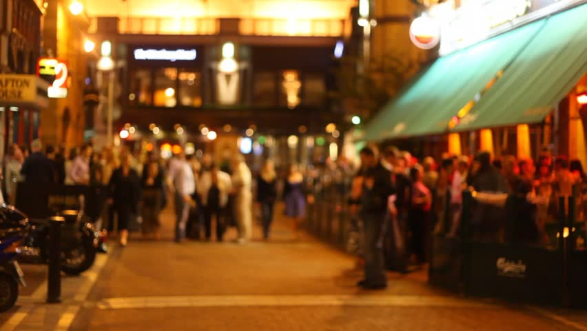 Defocused people walking in the streets of Dublin during the evening