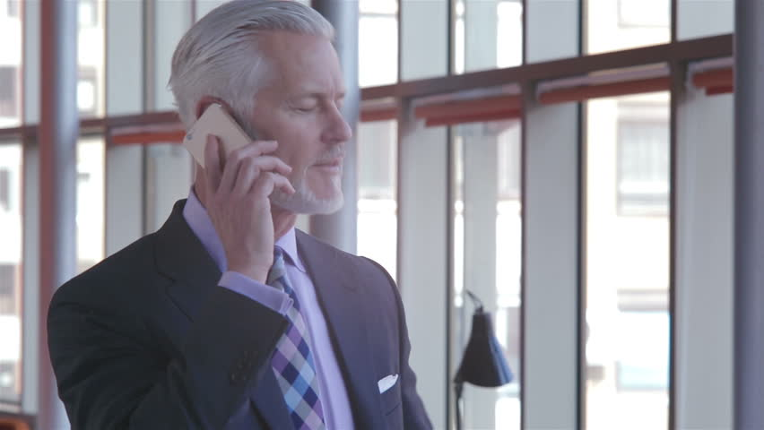 Senior business man talking by phone
