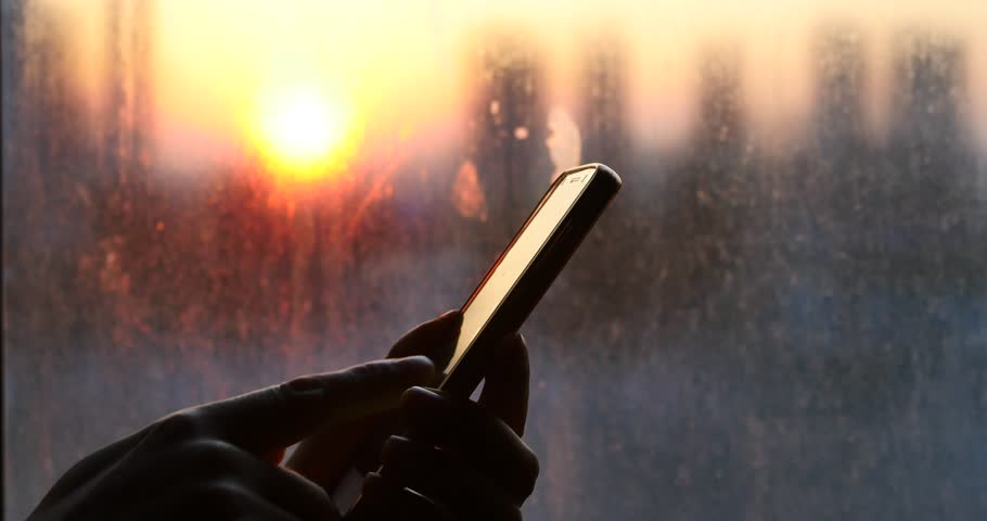4k Browsing news On Smartphone,Search information on website in the sunset. gh2_10840_4k