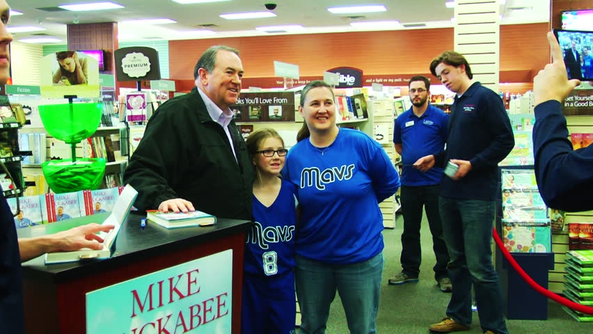 SHREVEPORT, LOUISIANA/USA - FEBRUARY 7, 2015: American politician Mike Huckabee signs fans' copies of his book, 'God, Guns, Grits, and Gravy.' | Shutterstock HD Video #9403508