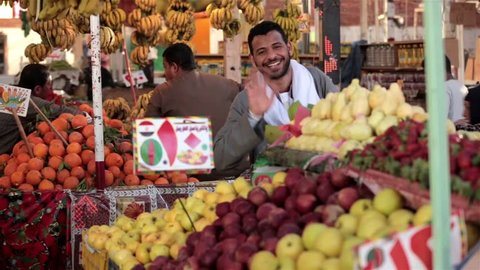HURGHADA, EGYPT - MARCH 20, 2015 Arabic traditional farmer market sell fresh fruits and vegetables on a covered bazaar on MARCH 20, 2015 in HURGHADA MARKET, EGYPT.