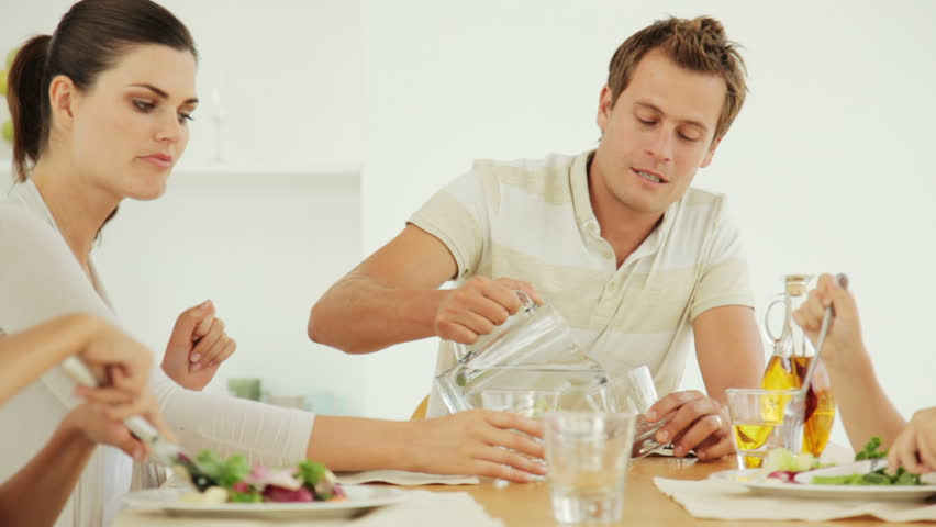 Family of Four Eating Salad | Shutterstock HD Video #941389