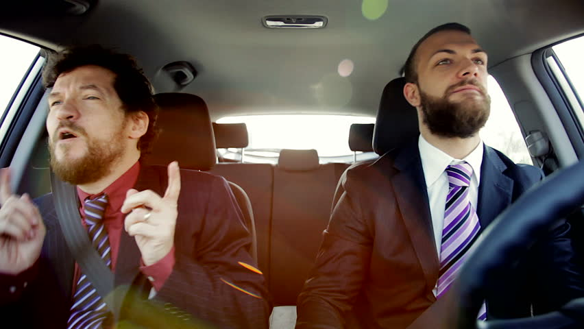 Two happy cool business men listening music dancing in car   Shutterstock HD Video #9421982