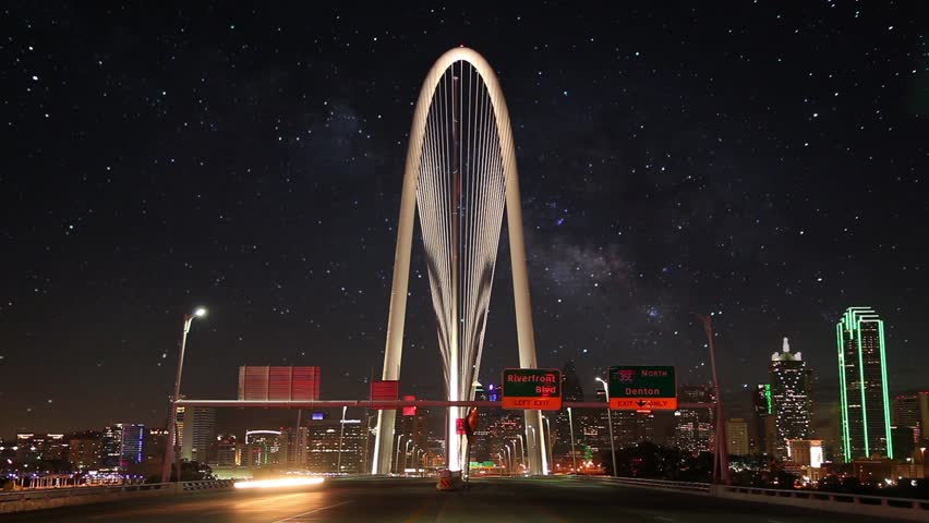 Dallas Skyline with Milky way stars animating time lapse w/ Margaret Hunt Hill bridge