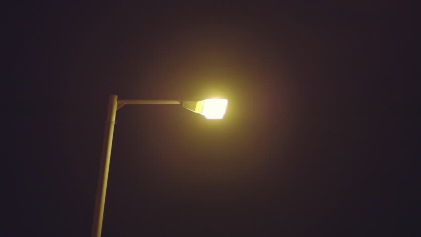 Street lamp power outage blackouta city street lamp post suddenly city street lamp flickers turns on after power outagea street lamp pole turns on mozeypictures Images