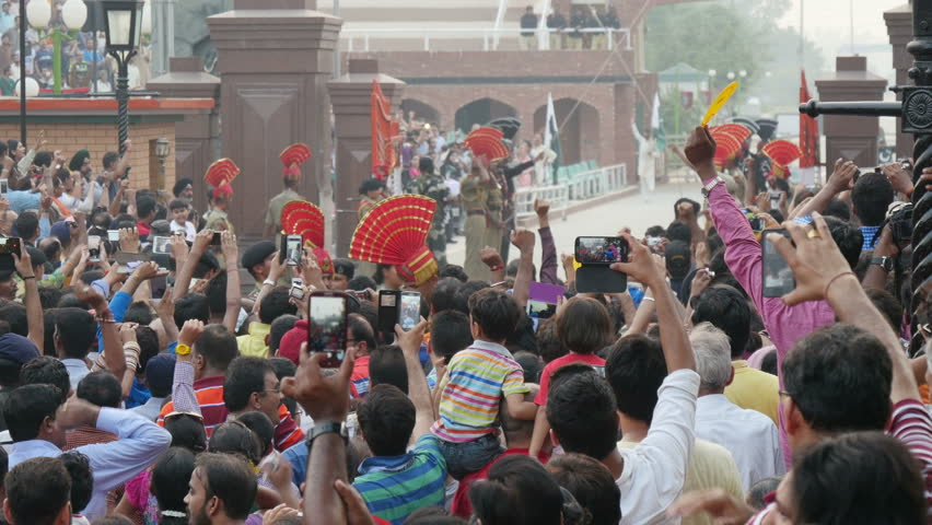 AMRITSAR, INDIA - 4 OCTOBER 2014: A large crowd have gathered to take pictures of the Amritsar and Wagah border ceremony at the Indian Pakistan border.
