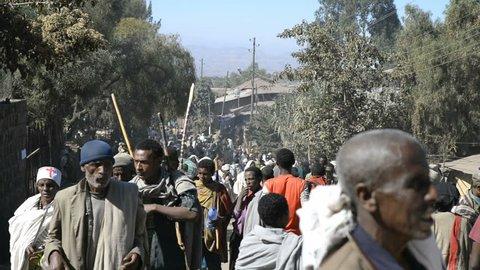 LALIBELA, ETHIOPIA - January 4, 2015 - Pilgrims Pilgrims and local people on Main Street in Lalibela on Januar 4, 2015 in Lalibela, Ethiopia.