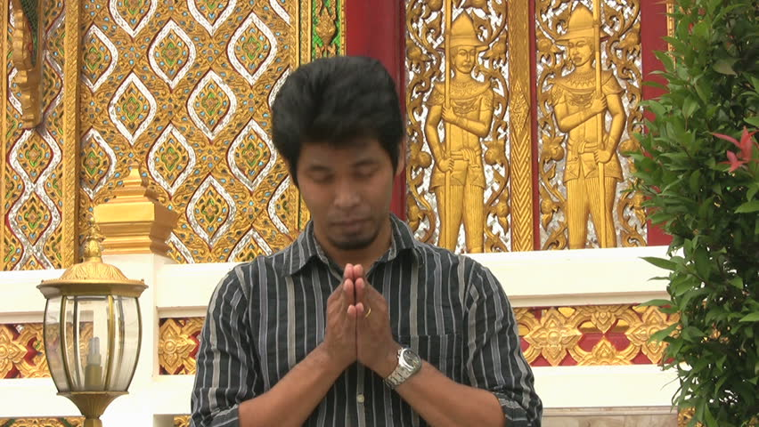 An asian man doing a thai style greeting in bangkok thailand stock an asian man doing a thai style greeting in bangkok thailand stock footage video 950248 shutterstock m4hsunfo Gallery